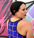 wide pose back of blue and yellow plaid rickshaw tank top