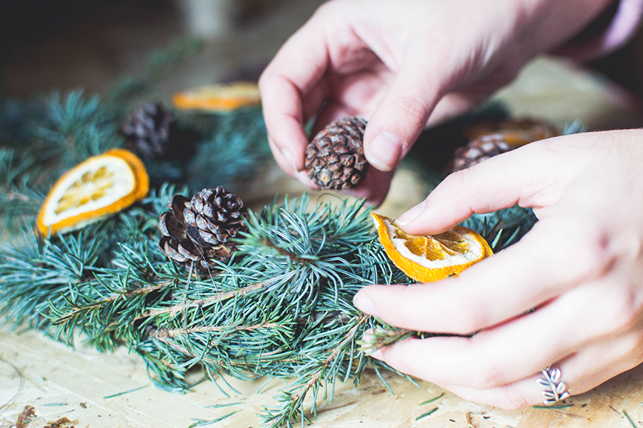 Attach pine cones to DIY natural Christmas wreath how-to
