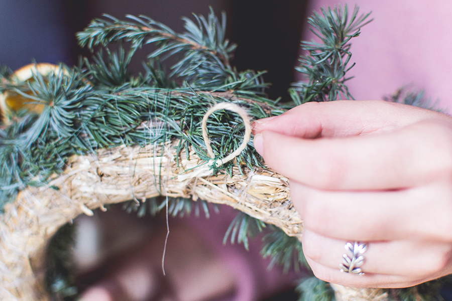 Create a hanging loop in your DIY natural Christmas wreath