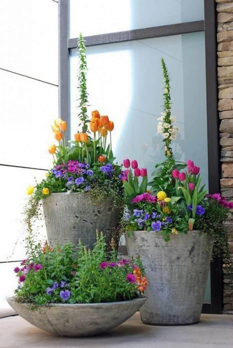 concrete planters with wildflowers spring diys